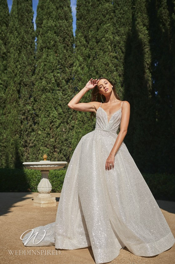 A Monique Lhuillier sparkly ball gown wedding dress with thin straps and crystals