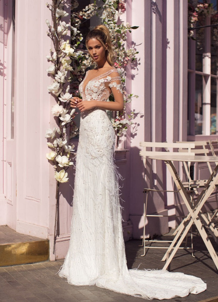 A Milla Nova lace and beading mermaid wedding dress with a v neckline