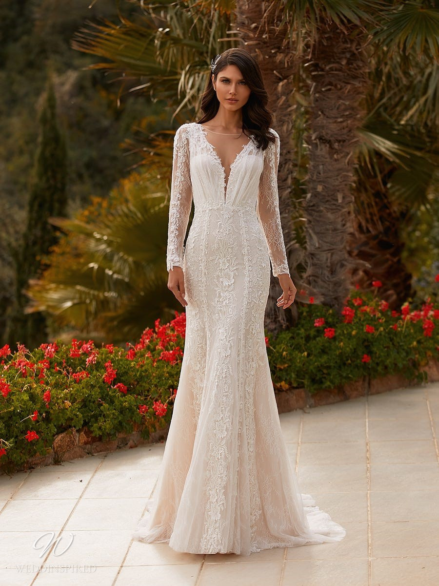 A Pronovias 2021 romantic lace mermaid wedding dress with long sleeves and a v neckline