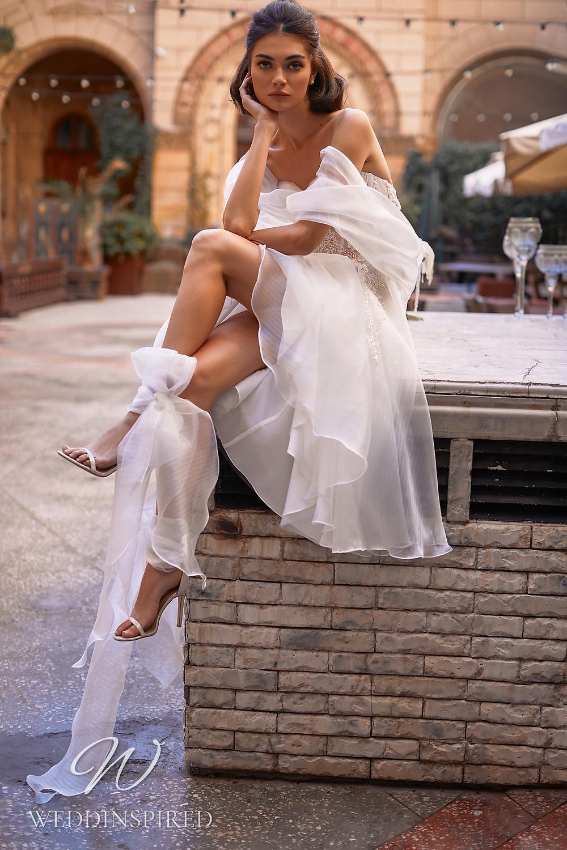 A Daria Karlozi 2021 strapless short chiffon wedding dress