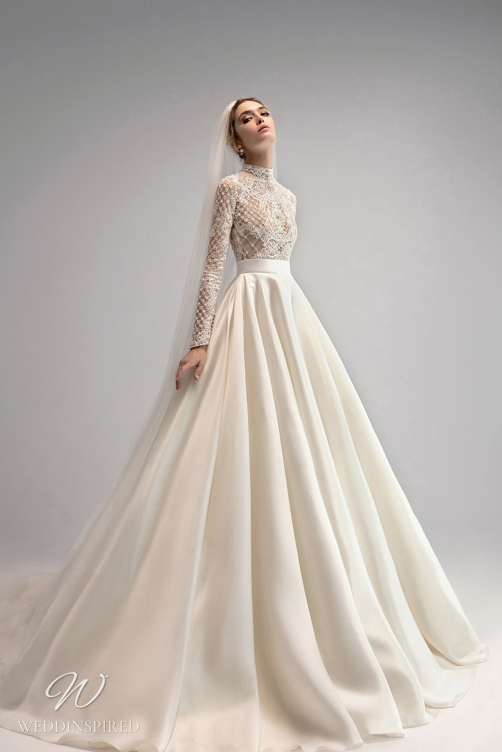 An Ersa Atelier 2021 ball gown wedding dress with silk detachable skirt and modest lace bodice with long sleeves