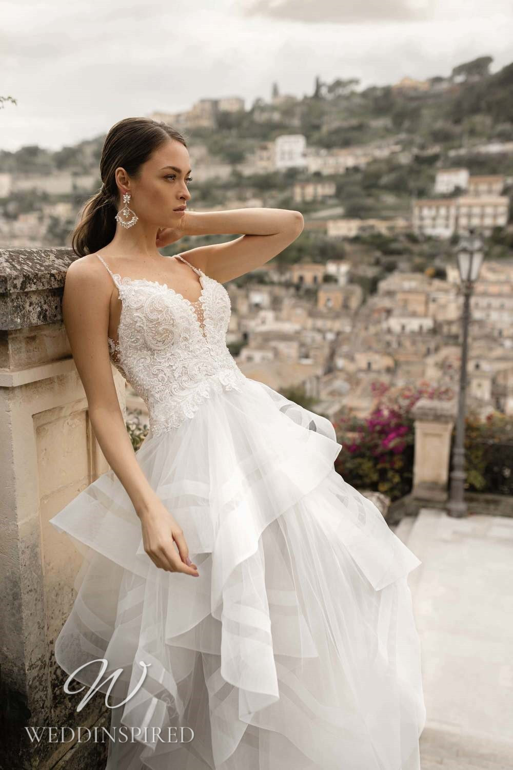 A Lussano 2021 lace and tulle A-line wedding dress with a layered ruffle skirt