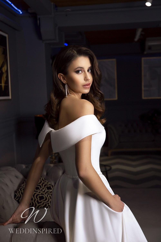 A Tina Valerdi satin off the shoulder tea length wedding dress
