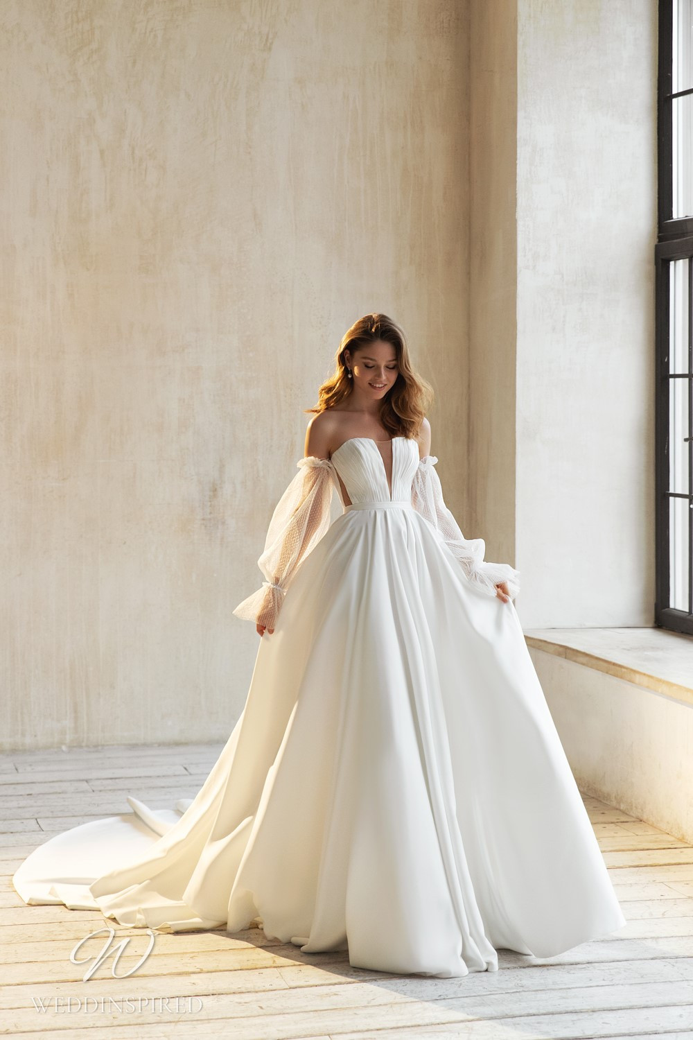An Eva Lendel 2021 crepe gypsy boho style ball gown wedding dress with long sleeves