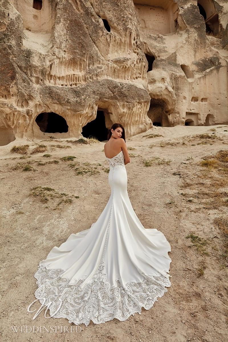 An Eddy K 2021 strapless lace and satin mermaid wedding dress