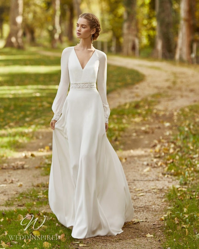 An Aire Barcelona 2021 flowy chiffon A-line wedding dress with a v neck and long sleeves