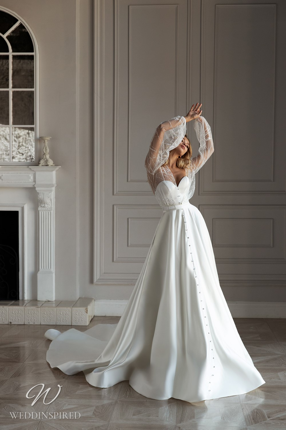 An Eva Lendel 2021 simple strapless silk ball gown wedding dress with buttons and a sweetheart neckline