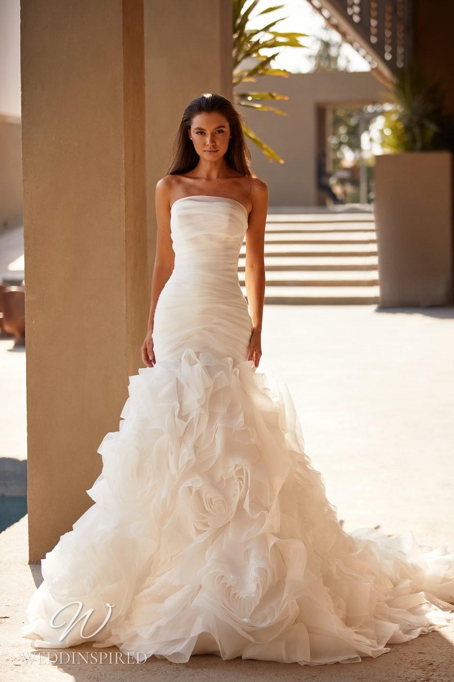 A Milla by Lorenzo Rossi 2021/2022 strapless chiffon mermaid wedding dress with a ruffle skirt