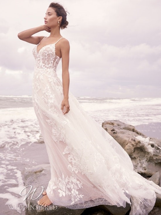 A Sottero & Midgley Spring 2021 lace and tulle A-line wedding dress with thin straps and a v neck
