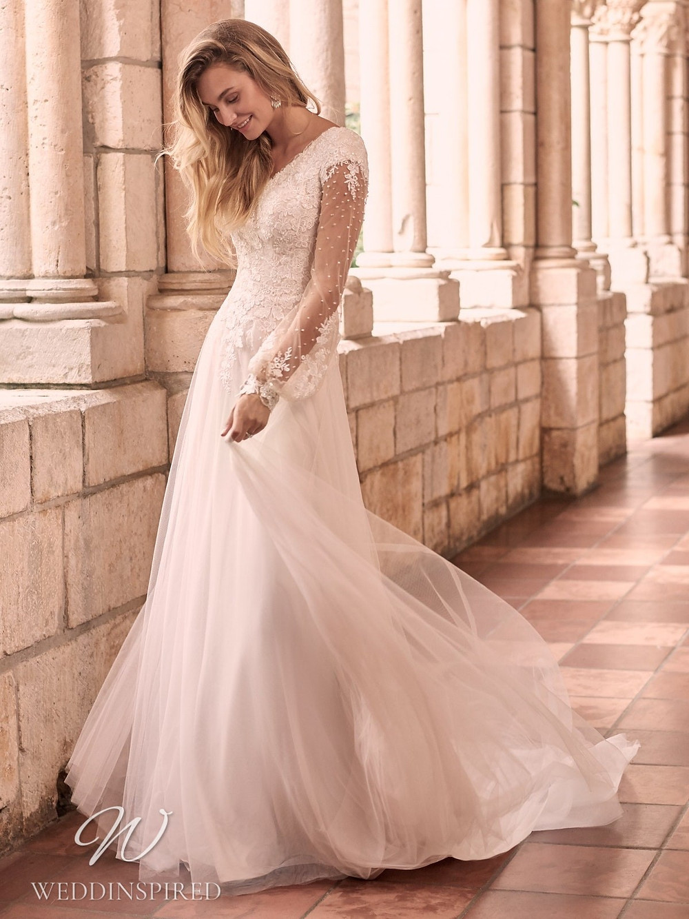 A Maggie Sottero Spring 2021 lace and tulle A-line wedding dress with long sleeves and a v neckline