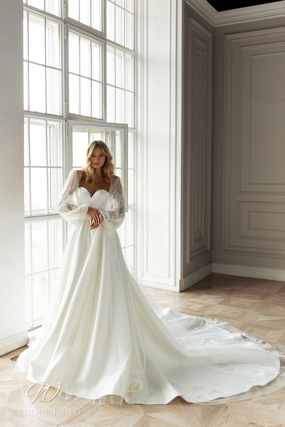 An Eva Lendel 2021 strapless silk ball gown wedding dress with a sweetheart neckline and a train