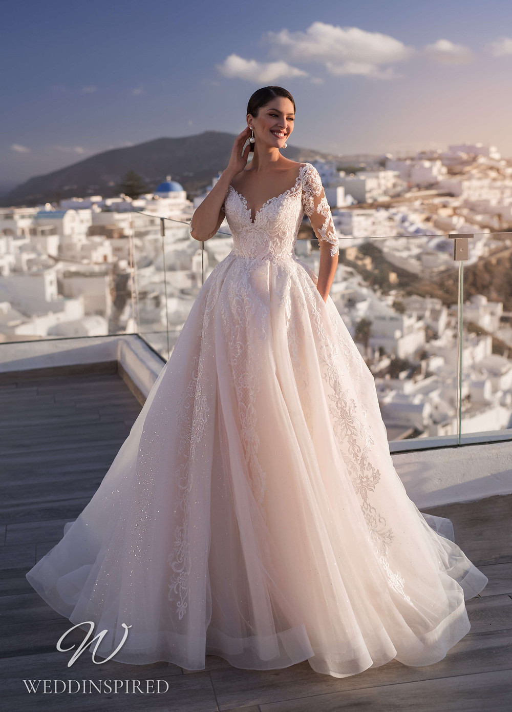 A Blunny 2021 blush lace and tulle princess wedding dress with 3/4 sleeves