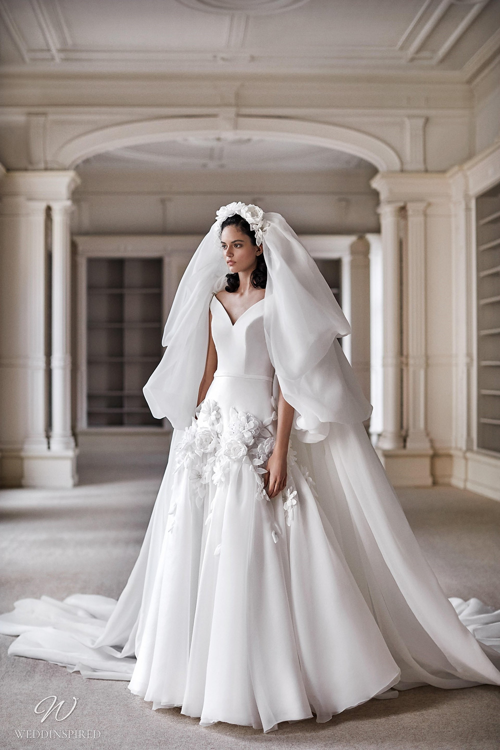 A Viktor & Rolf 2021 soft off the shoulder princess ball gown wedding dress with chiffon skirt and flowers