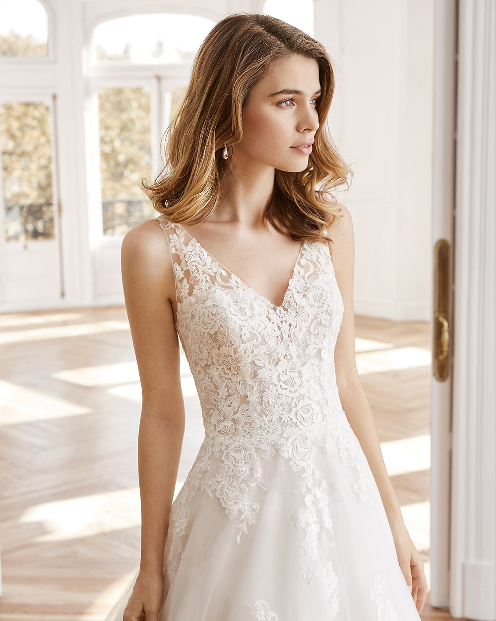 An Aire Barcelona 2020 lace and tulle A-line wedding dress with a v neckline