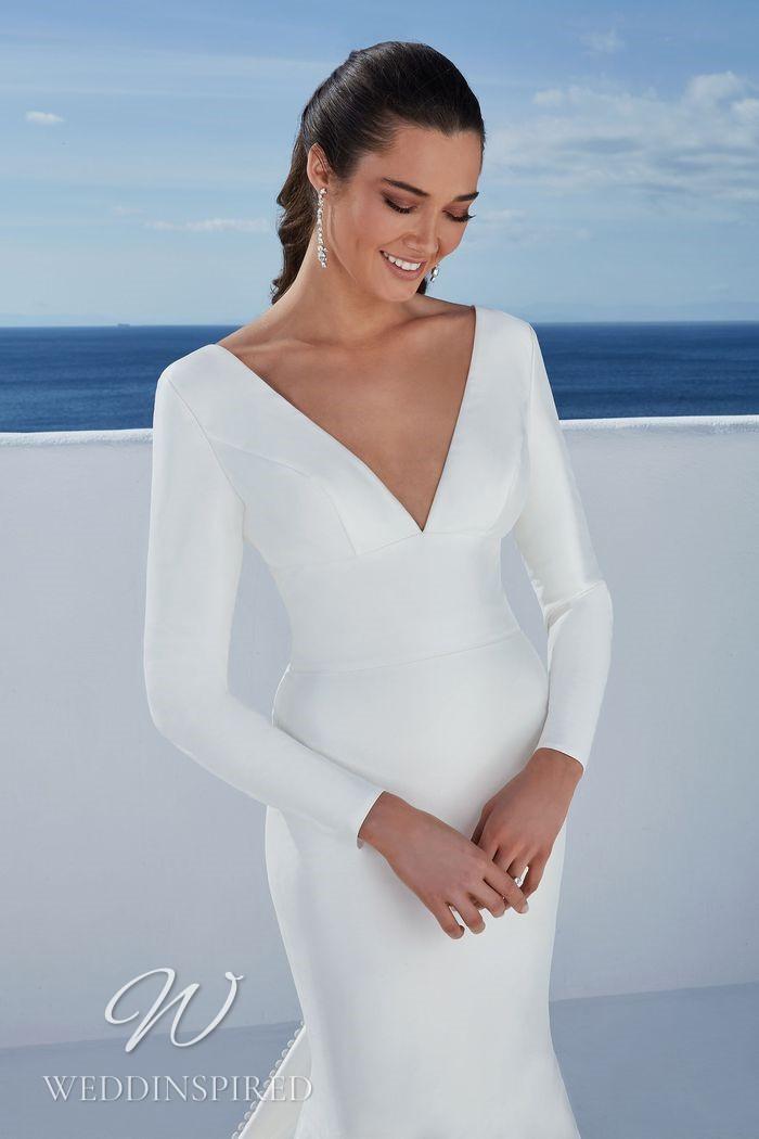 A Justin Alexander 2021 simple satin mermaid wedding dress with long sleeves