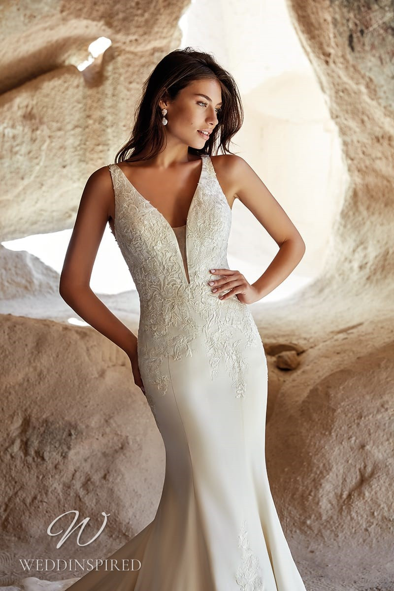 An Eddy K 2021 satin and lace mermaid wedding dress with a v neck
