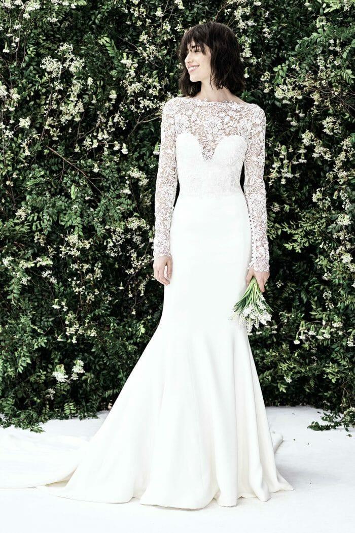 A Carolina Herrera lace mermaid wedding dress with long sleeves