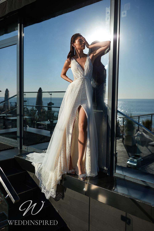An Ida Torez 2021 lace A-line wedding dress with a v neck