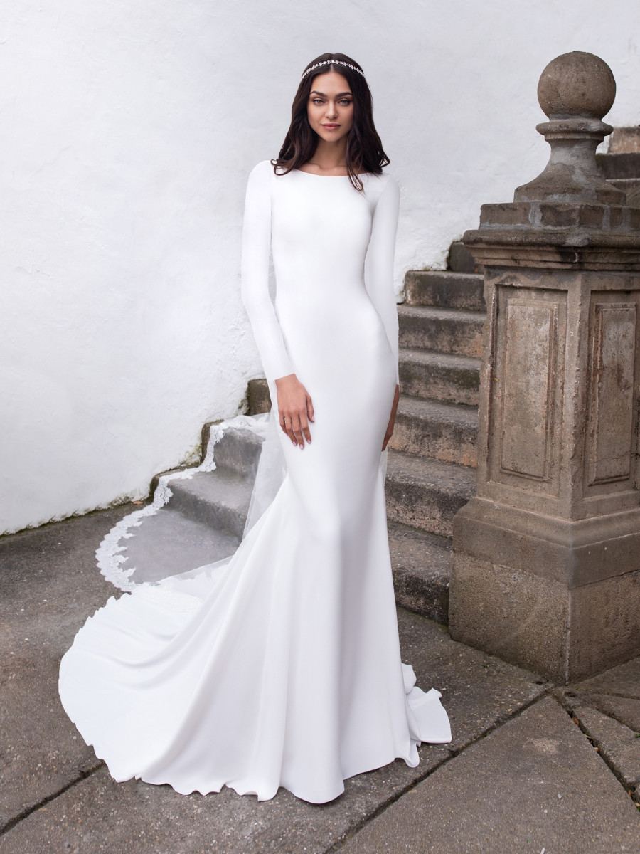 A Pronovias simple modest fit and flare wedding dress with long sleeves
