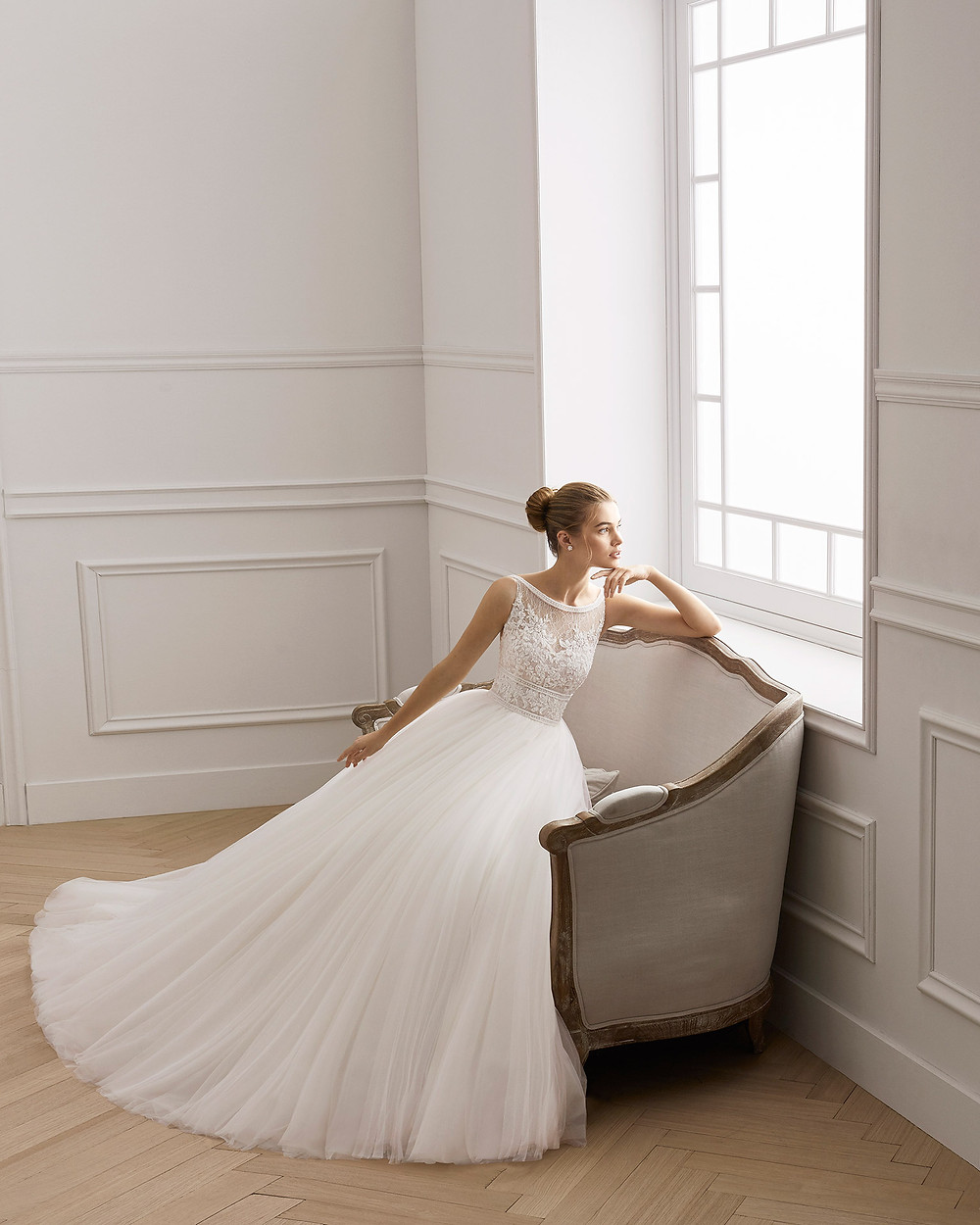 An Aire Barcelona 2020 lace and tulle ball gown wedding dress with an illusion top