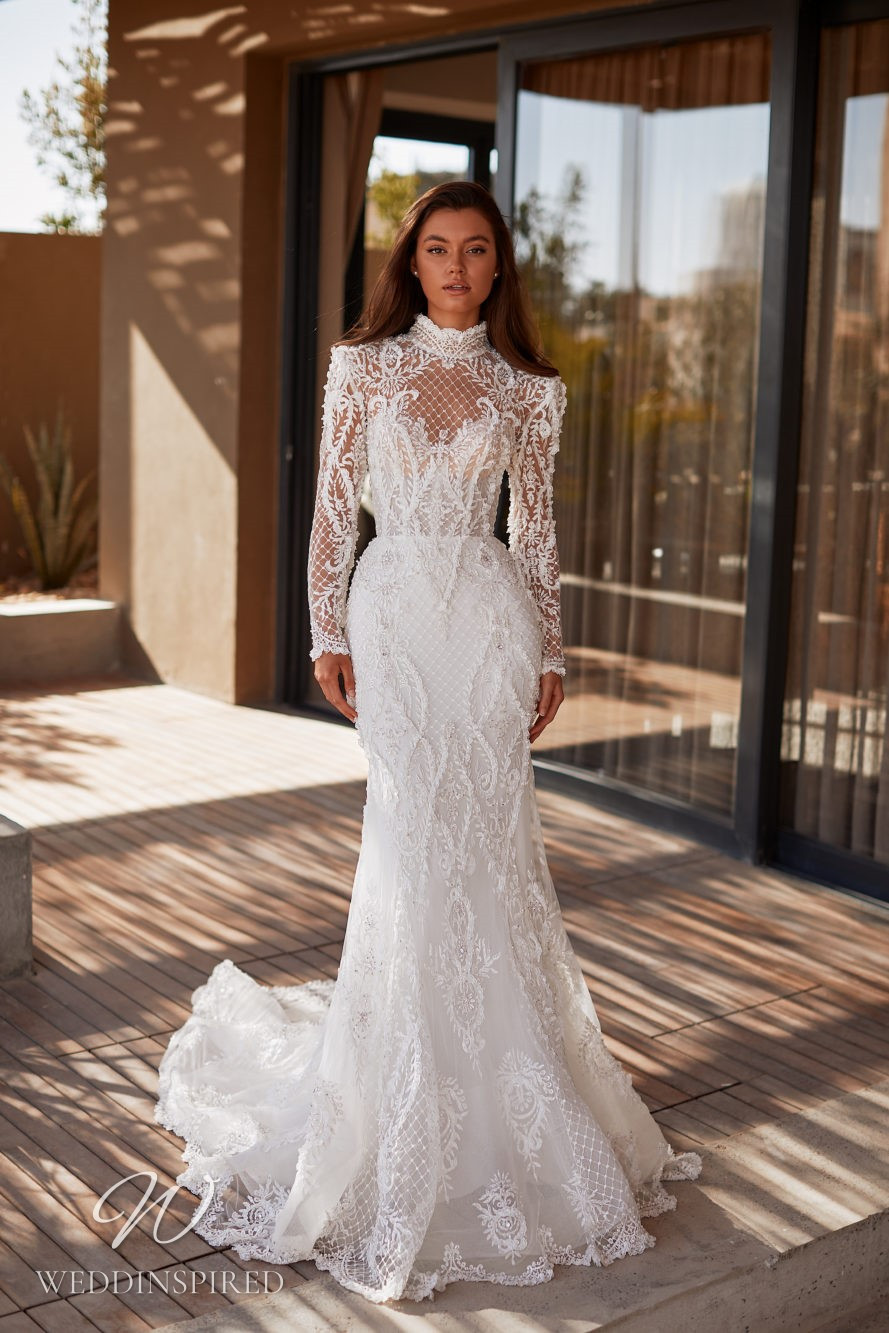 A Milla by Lorenzo Rossi 2021/2022 detailed and intricate lace mermaid wedding dress with long sleeves and a high neckline