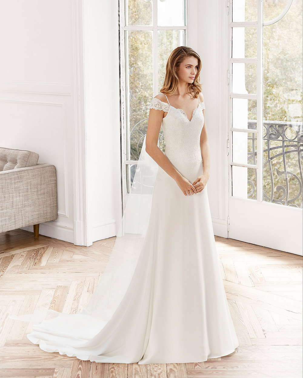 An Aire Barcelona 2020 lace and silk off the shoulder A-line wedding dress