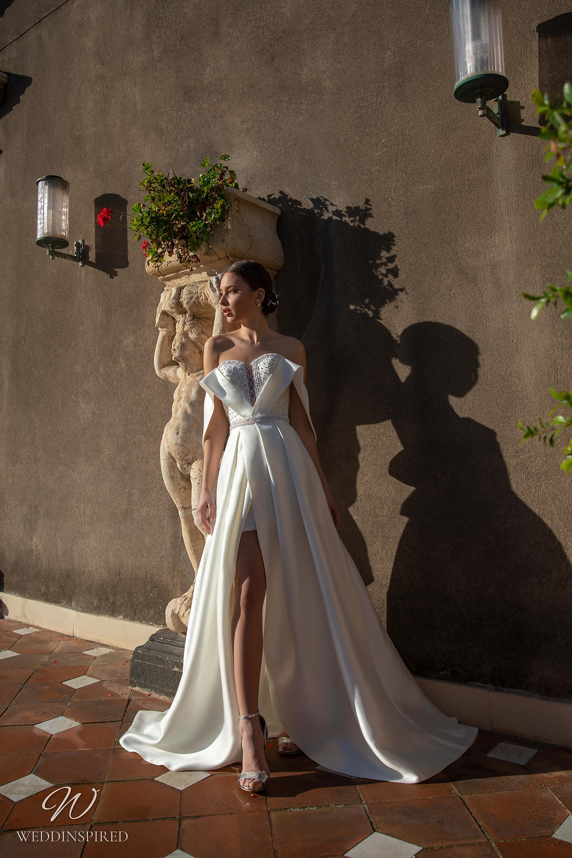 A Naviblue strapless A-line wedding dress with a high slit