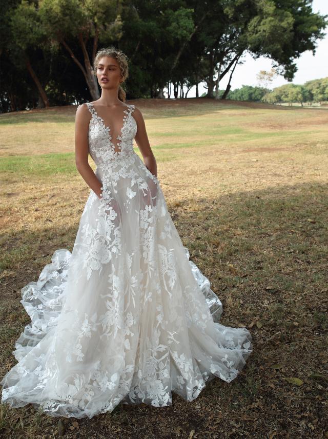 A Galia Lahav lace and mesh A-line wedding dress with pockets and a v neckline