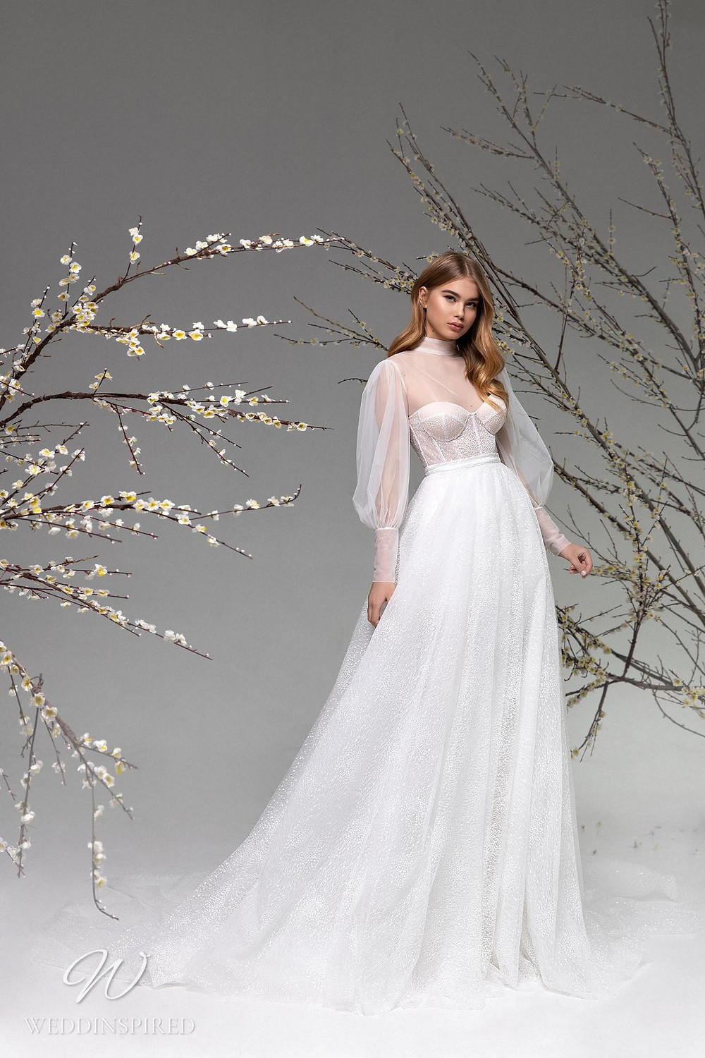 A Ricca Sposa mesh and tulle A-line wedding dress with long sleeves