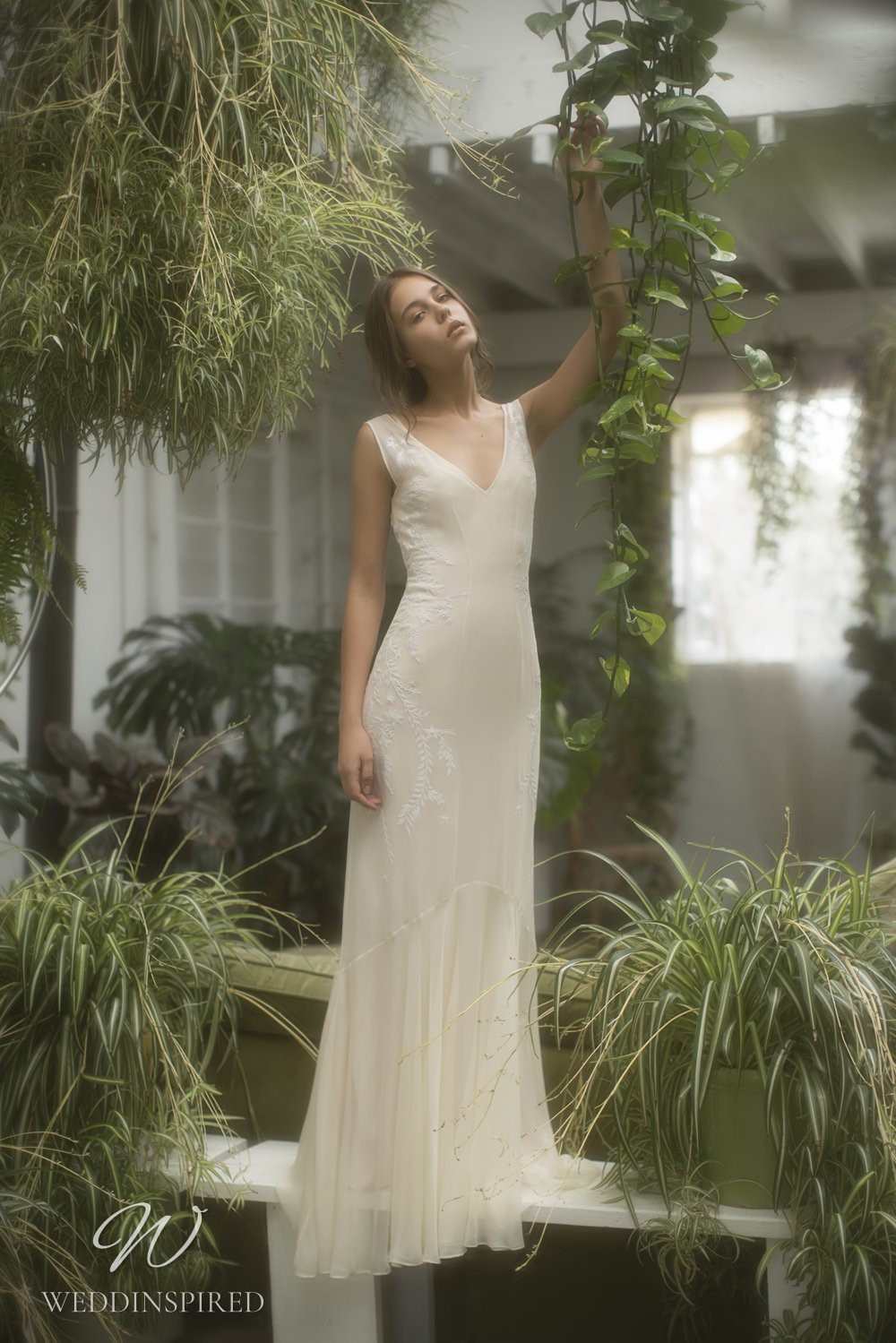 An Olwen Bourke soft flowy chiffon sheath wedding dress with a v neck
