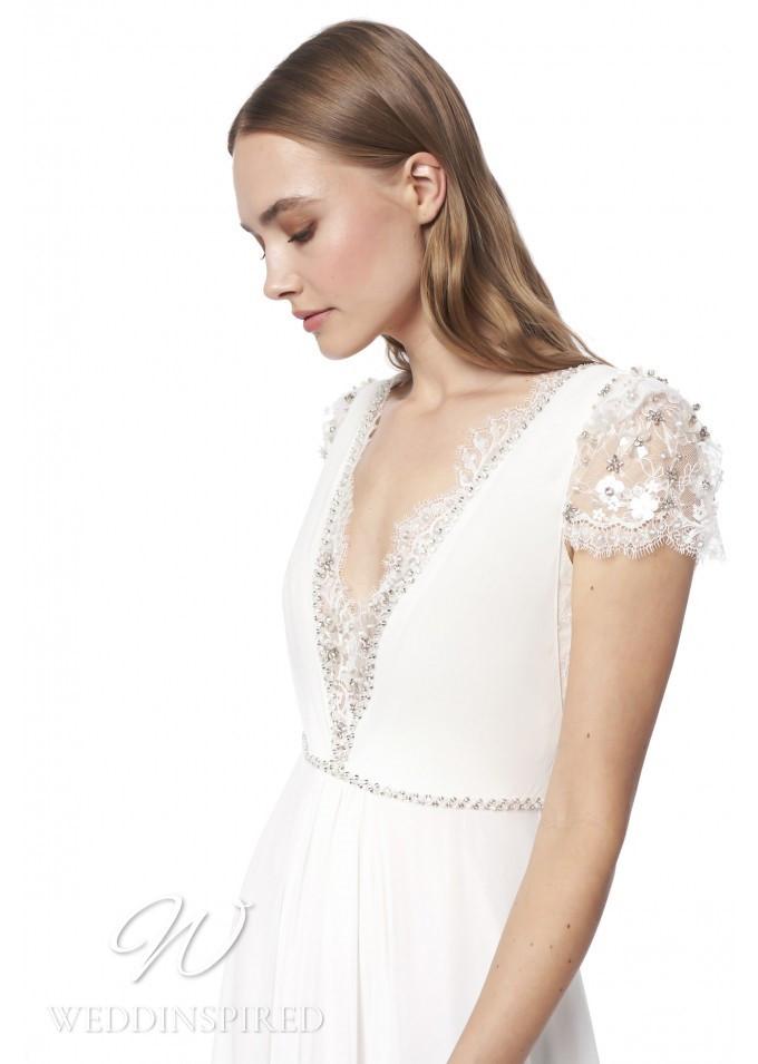 A Jenny Packham 2021 sheath wedding dress with a v neckline and cap sleeves