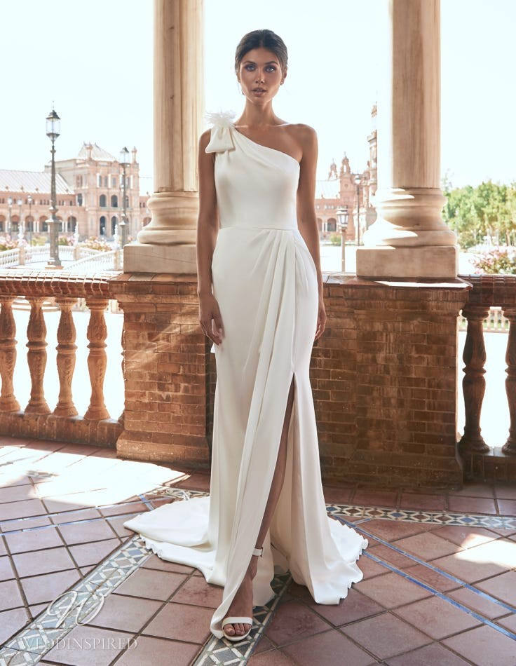 A Marchesa for Pronovias 2022 simple satin one shoulder sheath wedding dress with a slit
