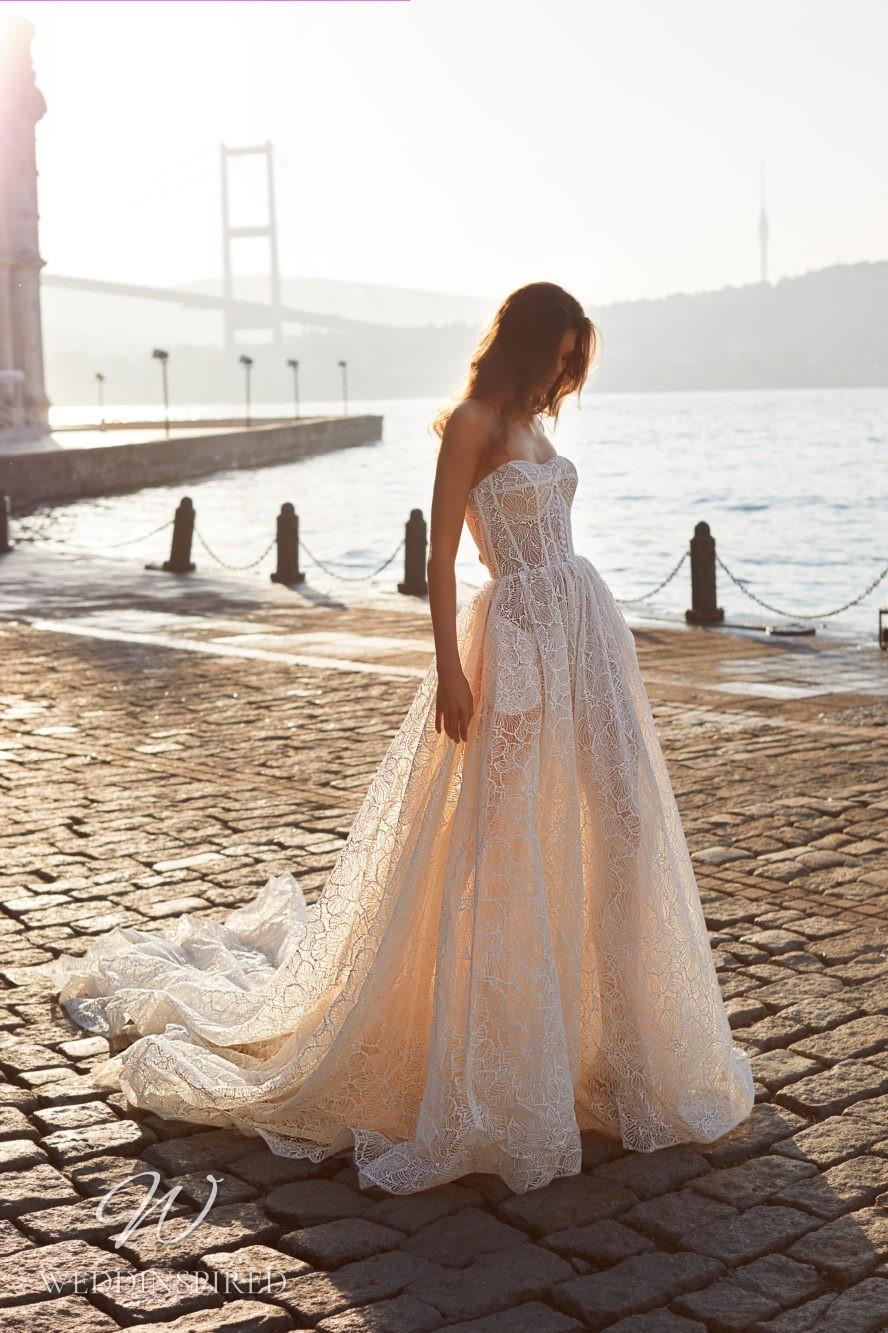 A Milla Nova 2021 strapless blush A-line wedding dress with a train