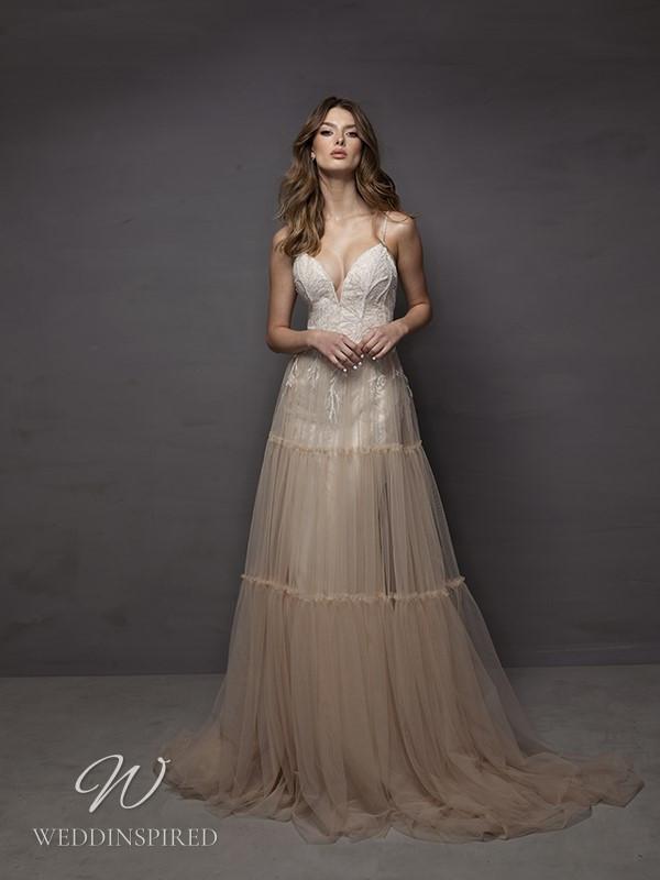A Riki Dalal 2021 blush lace and tulle A-line wedding dress