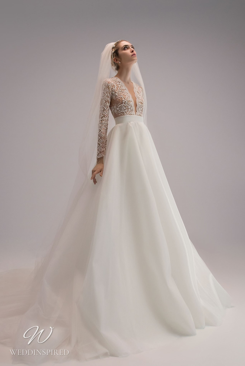 An Ersa Atelier 2021 ball gown wedding dress with a silk skirt and a lace bodice with long sleeves and beading