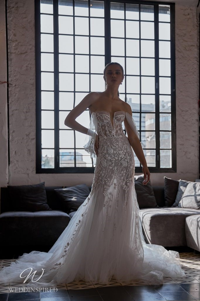 A Julie Vino 2021 lace and tulle tan / beige off the shoulder mermaid wedding dress