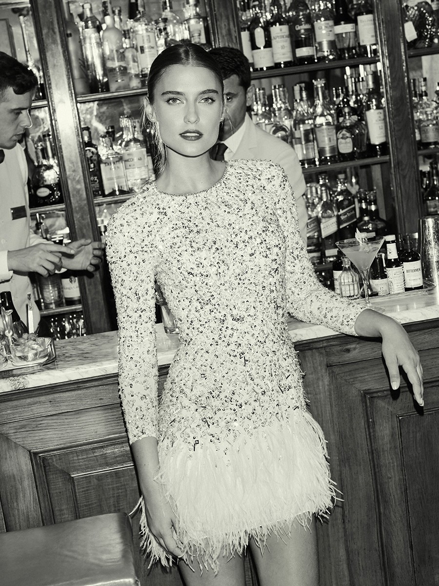 A Jenny Packham sexy sparkly beaded feather short wedding dress with long sleeves