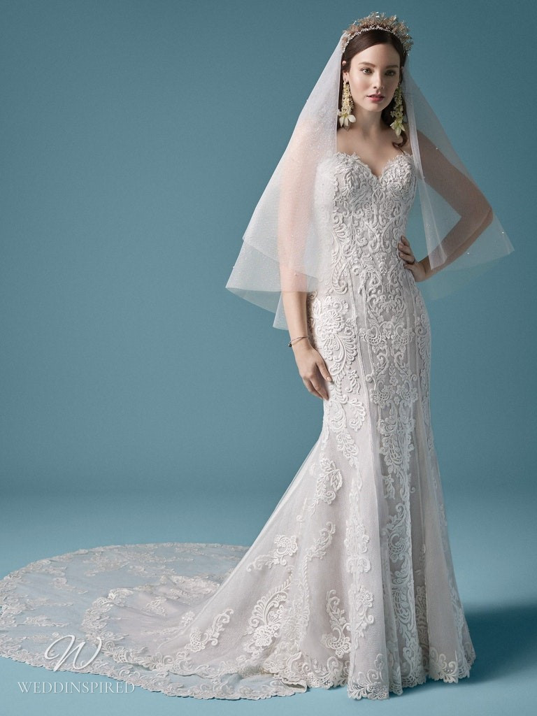 A Maggie Sottero 2021 strapless lace mermaid wedding dress with a train