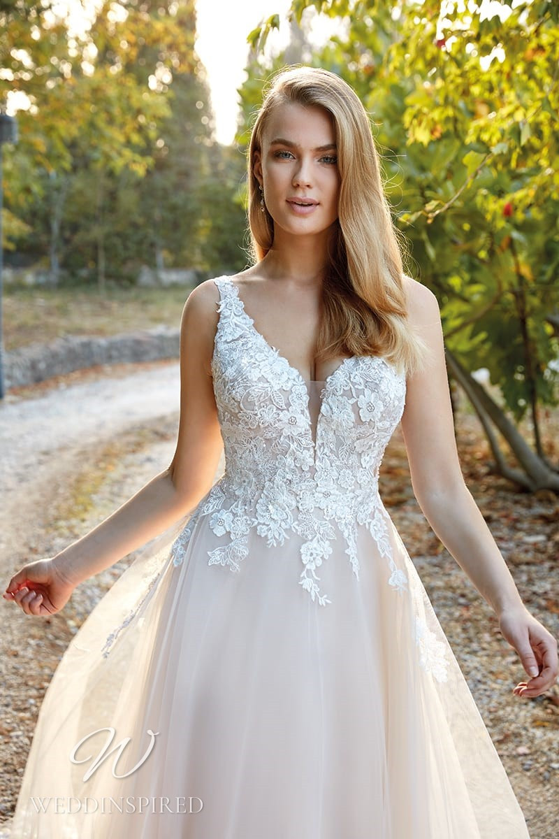 An Eddy K 2022 lace and tulle A-line wedding dress
