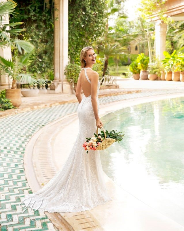 A Rosa Clara 2021 lace mermaid wedding dress with an open back