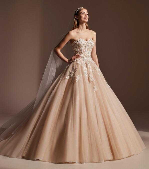A Pronovias tan blush tulle princess ball gown wedding dress