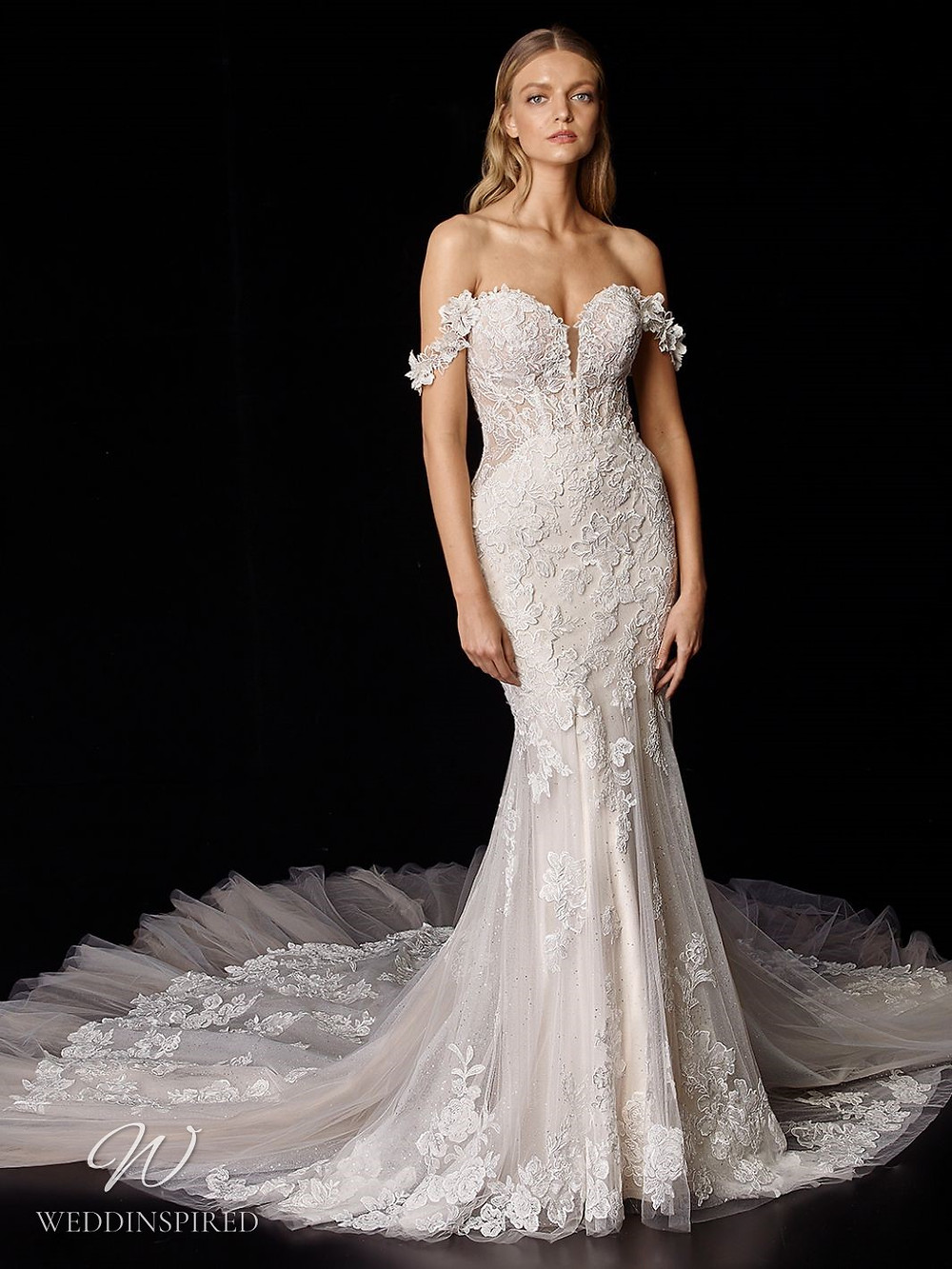 An Enzoani off the shoulder lace and tulle mermaid wedding dress with a train