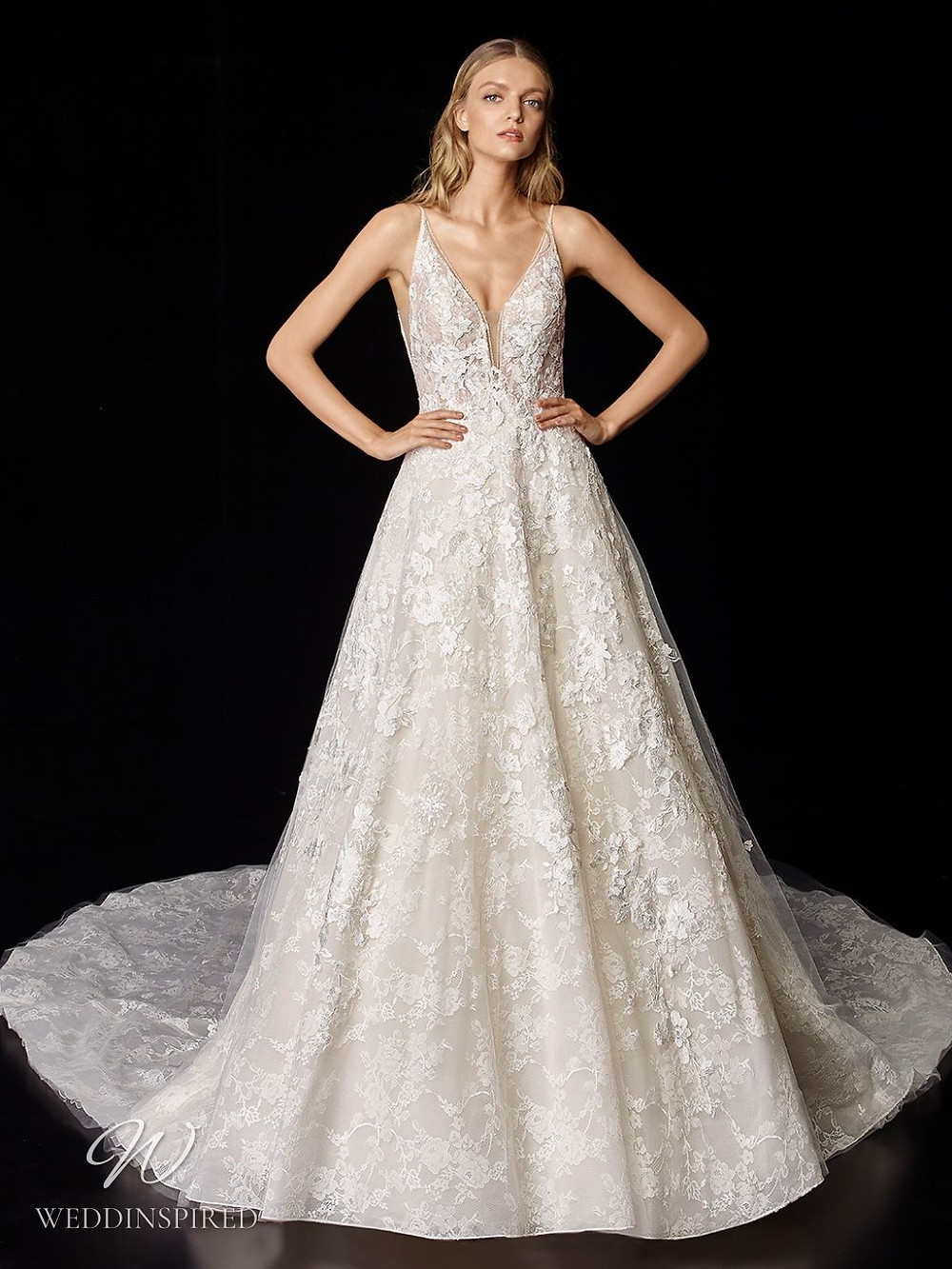 An Enzoani lace A-line wedding dress with a v neckline and a train