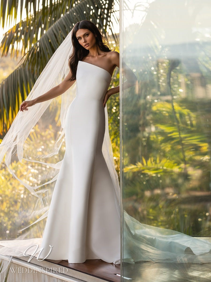 An Ashley Graham x Pronovias 2021 simple strapless satin mermaid wedding dress