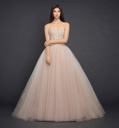 A Lazaro blush tulle ball gown wedding dress