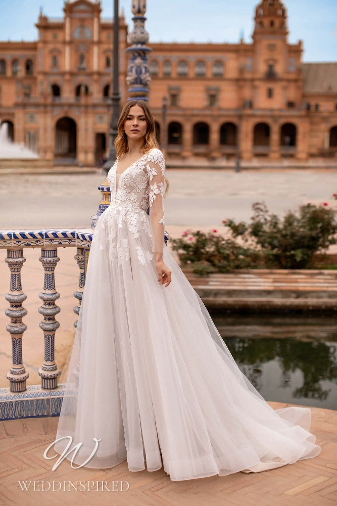 A Nora Naviano 2021 lace and tulle A-line wedding dress with long sleeves