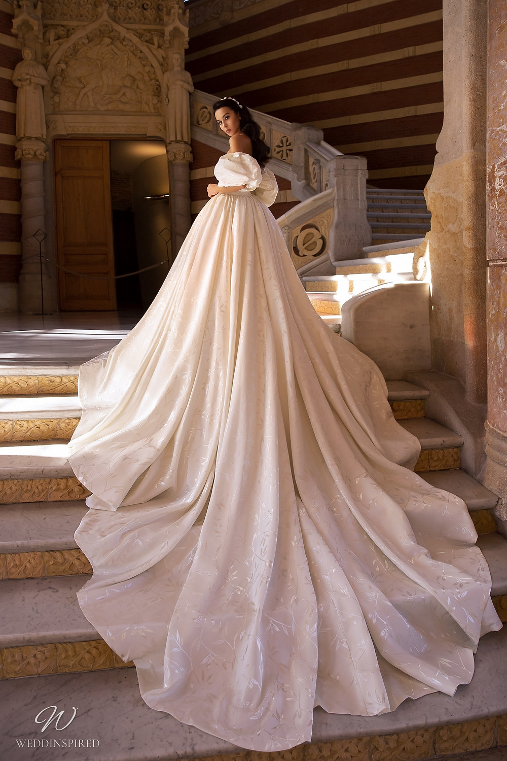 A Maks Mariano ivory off the shoulder princess ball gown wedding dress
