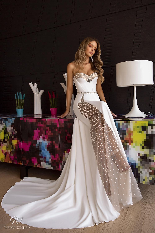 A Tina Valerdi strapless mermaid wedding dress with polka dot detail and a sweetheart neckline