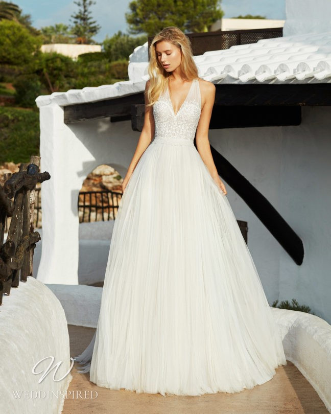 An Aire Barcelona 2021 tulle and lace halterneck A-line wedding dress