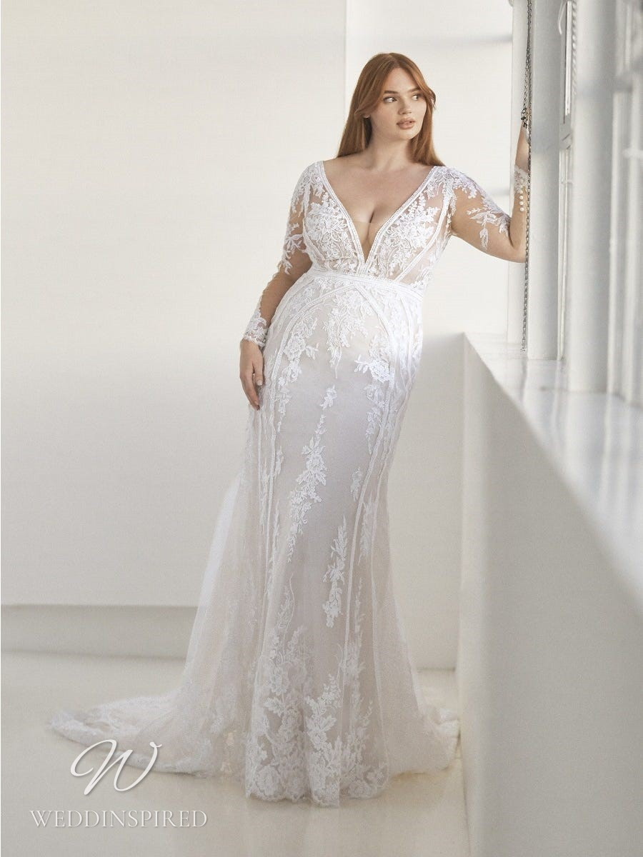 An Ashley Graham x Pronovias 2021 plus size lace mermaid wedding dress with long sleeves and a v neck